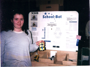 Jennifer in her sixth-grade science fair presenting School-Bot, a robot courier for schools, built with LEGO MINDSTORMS. She is still interested in developing robots for schools almost two decades later.